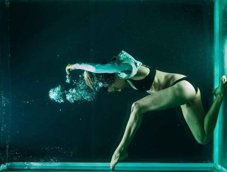 woman in black bikini underwater photography